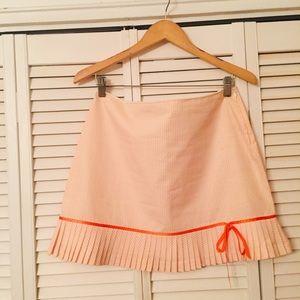 Mini orange and white skirts